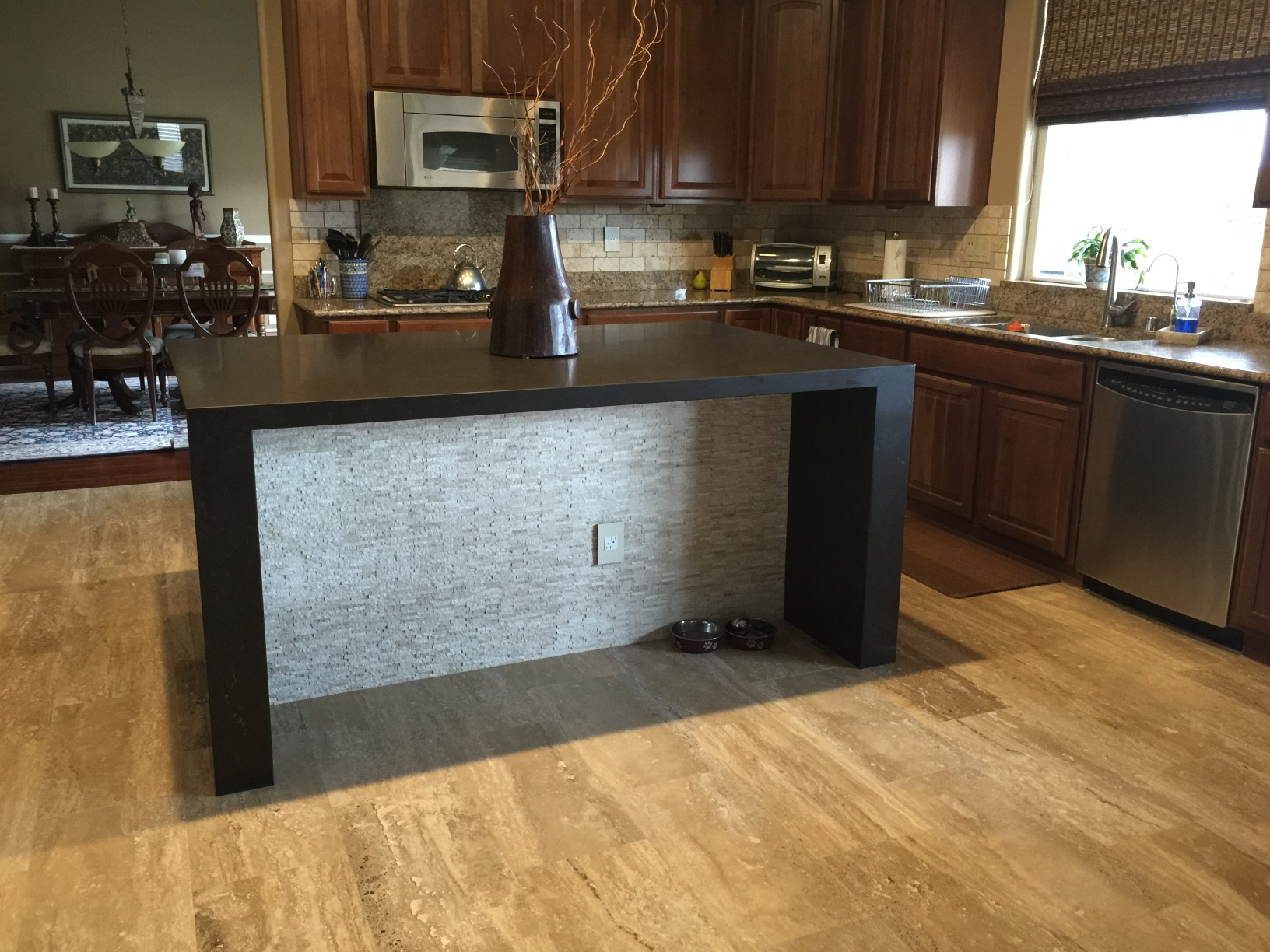 Waterfall kitchen island with new flooring and bathroom for Las vegas bathroom remodeling companies